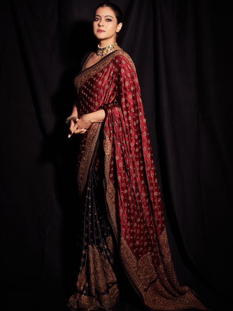 Kajol in a Black & Burgundy Embroidered Saree With Stitched Blouse