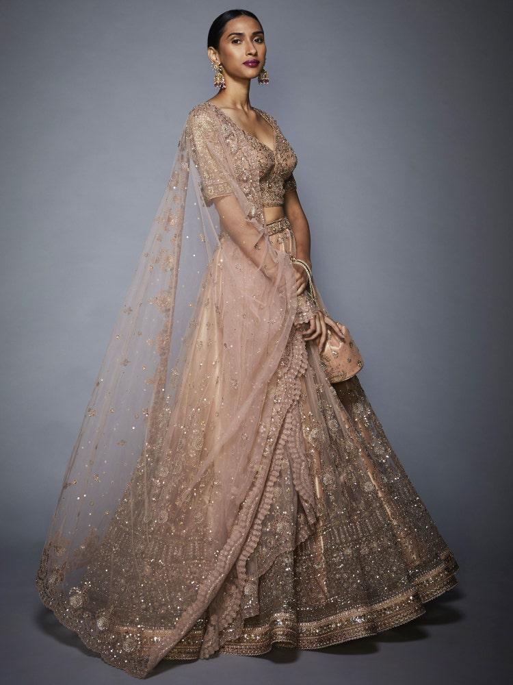 Sobhita Dhulipala In A Pastel Pink Treena Floral Net Lehenga Set