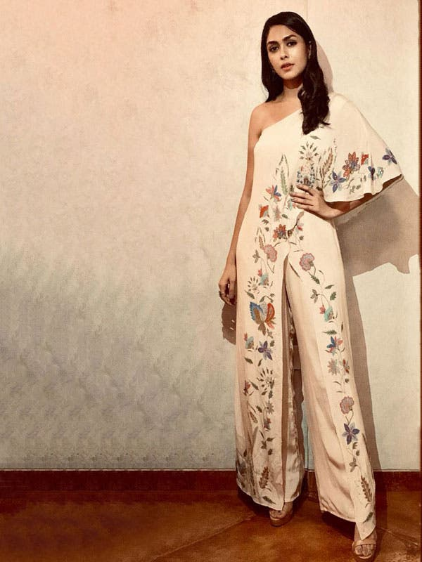 Mrunal Thakur in a Beige Floral One-Shoulder Jumpsuit