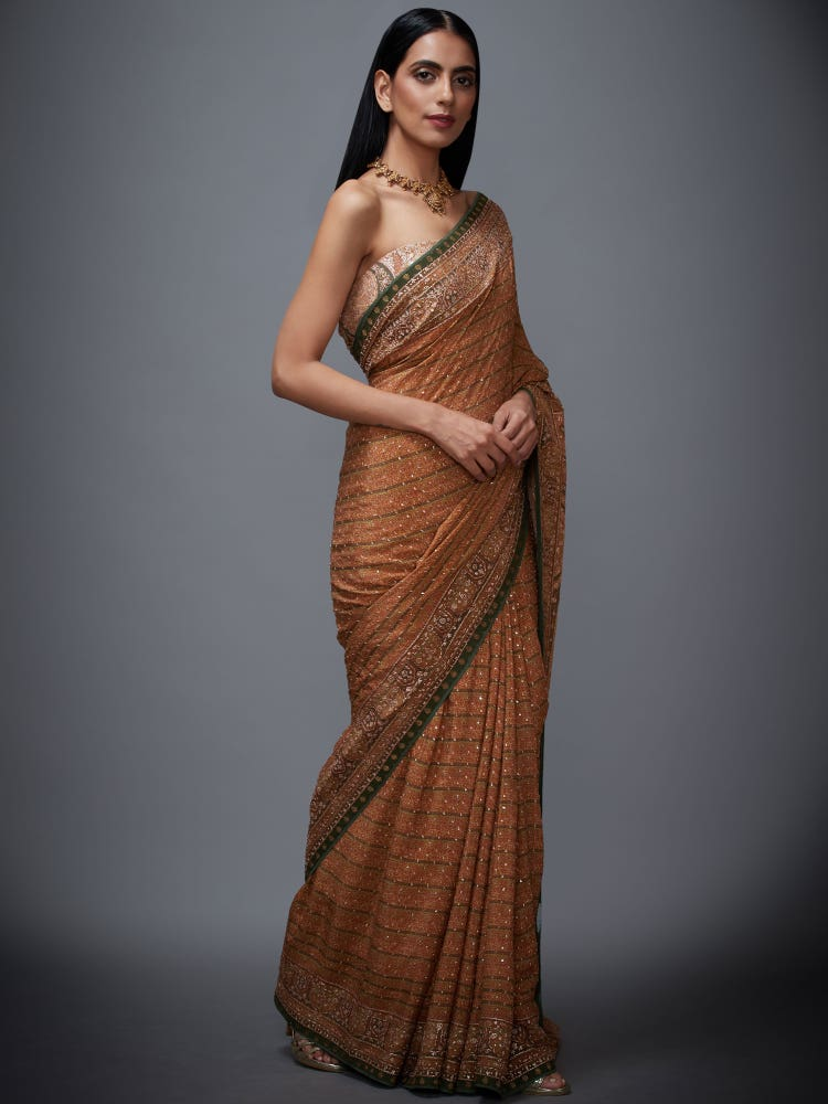 Surveen Chawla In A Beige & Olive Imran Coat Saree With Unstitched Blouse