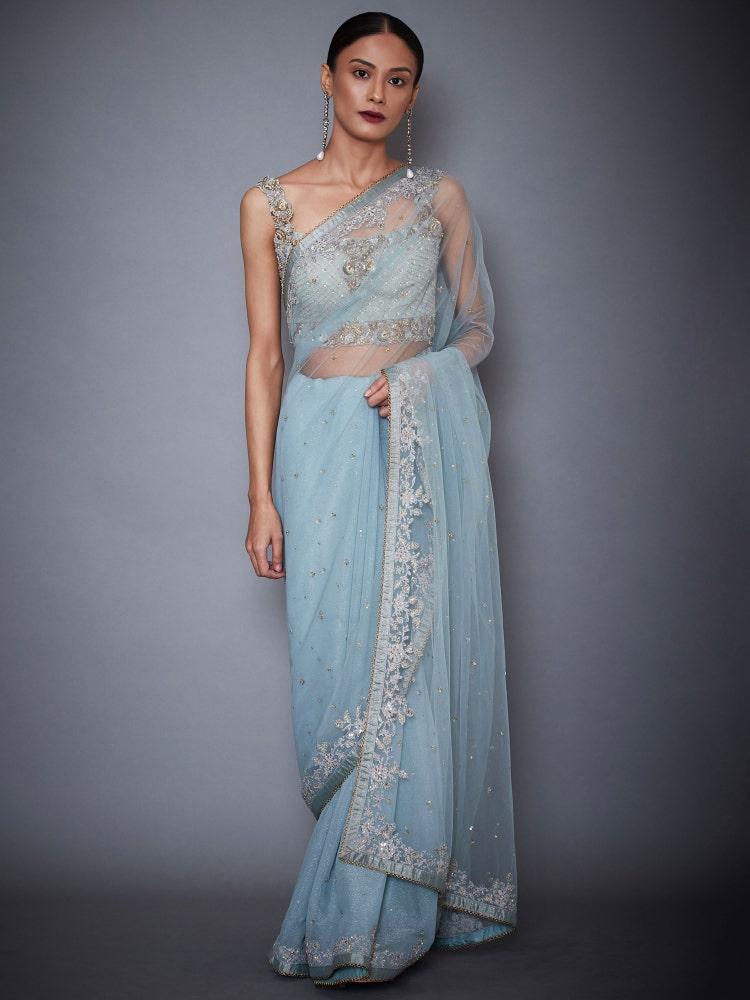 Powder Blue Rutvi Net Saree With Stitched Blouse